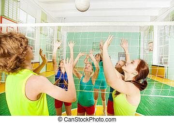 Volleyball match in school gymnasium