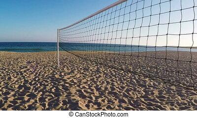 Volleyball net on beach in summer in Albufeira.