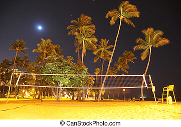 Volleyball net  on the beach at night