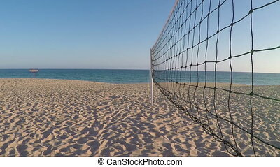 Volleyball net on the beach in summer in Portimao.