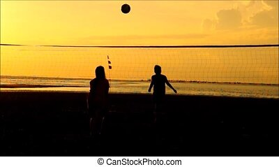 Volleyball on the beach, at Sunset