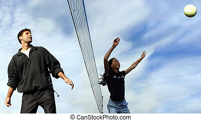 Volleyball players - A man and a girl playing volleyball