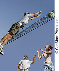 Volleyball players - Men and a girl playing volleyball