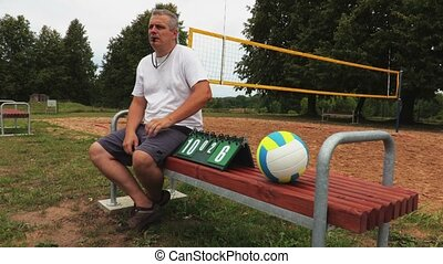 Volleyball referee with scoreboard