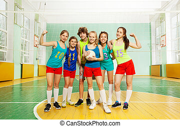 Volleyball winners standing together after match