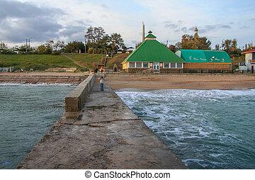 Volnorez on the beach in the village of Primorsky