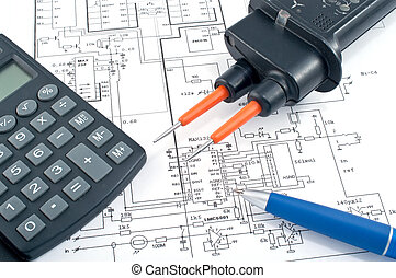 Voltage tester, calculator and pen on electrical diagram