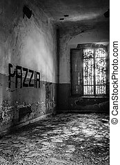 Volterra, Italy - September 2016: Abandoned psychiatric hospital in Volterra. It was home to more than 6,000 mental patients but was shut down in 1978 because its practices were deemed cruel. The hospital was called 'the place of no return' because patients supposedly never returned home. Volterra, ...