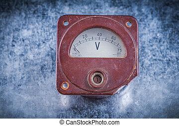 Voltmeter on scratched metallic background vintage electricity c