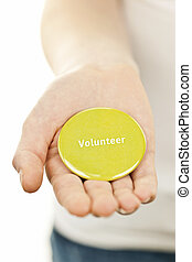 Volunteer button on hand