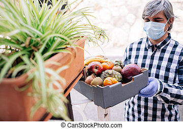 Volunteer delivering food in a box during Covid 19 quarantine