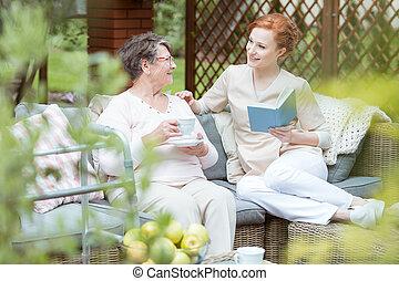Volunteer spending time with senior