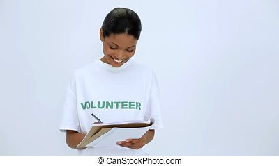 Volunteer woman thinking and writting on notebook on white...