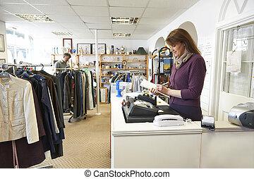 Volunteer Working In Charity Shop