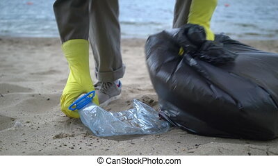 volunteers collecting garbage on a lonely beach