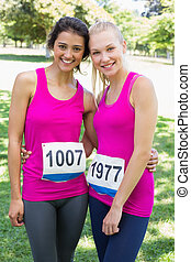 Volunteers participating in breast cancer marathon -...