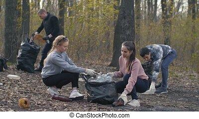 Volunteers picking up garbage plastic - Young volunteers ...