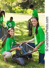Volunteers picking up litter in par