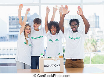 Volunteers raising their arms