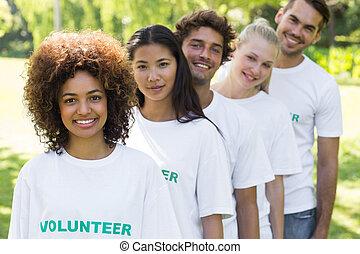 Volunteers standing in a line