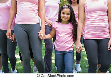 Volunteers supporting breast cancer campaign - Group of...