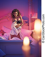 Voluptuous brunette in a romantic bedroom