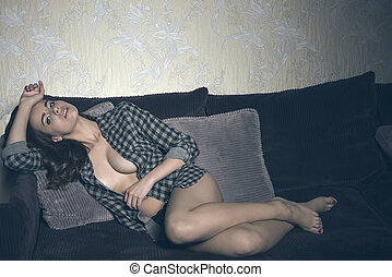voluptuous woman on sofa - very sexy brunette female with...