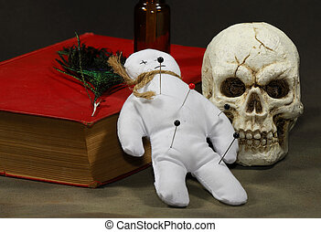 Voodoo Doll with a Book and a Skull