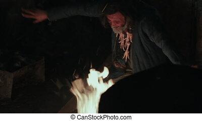 Voodoo sorcerer, dancing by the fire (shaman) - Voodoo cult...