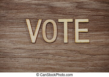 Vote Alphabet Letters on wooden background