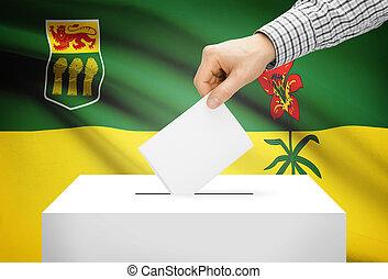 Voting concept - Ballot box with national flag on background - Saskatchewan