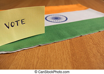 Voting concept - Hand Written Voting Sticker on Indian Flag