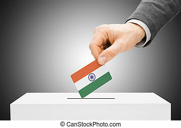 Voting concept - Male inserting flag into ballot box - India