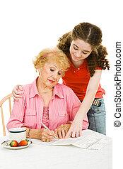 Voting - Helping Grandma with Paperwork - Teen girl helping...