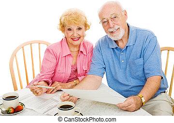 Voting - Seniors & Absentee Ballots - Senior couple using...