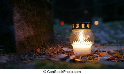 Votive candle on grave, Grave candle