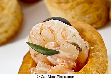 voulevant with shrimps and olives sauce close up - voulevant...