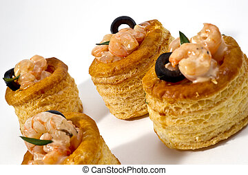 voulevant with shrimps and olives sauce on white background