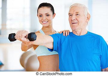 vous, are, faire, well!, gai, femme, kinésithérapeute, portion, homme aîné, à, fitness, dans, club santé