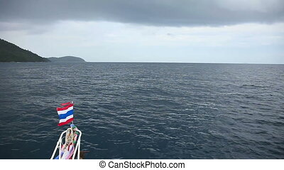 Voyage. - Trip on a motor boat with Thailand flag.