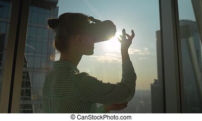 VR concept - young woman using virtual reality headset ...