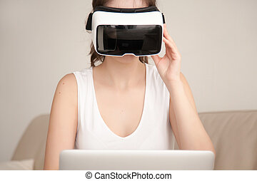 VR headset for laptop, young woman wearing virtual reality glass
