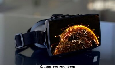 vr headset with 3d rendering of earth on screen - virtual,...