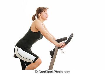 vrijstaand, jonge vrouw , zittende , op, een, het spinnen, fiets