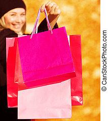 vrolijk, vrouw, op, winkel, verkoop