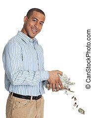 vrolijke , afrikaanse amerikaanse mens, gietend geld, door, pot