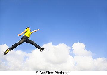vrolijke , jonge man, springt, en, richtend aan, hemel