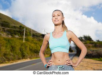vrolijke , jonge vrouw , doen, sporten, buitenshuis