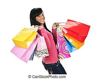 vrolijke , jonge, zwarte vrouw, met, het winkelen zakken