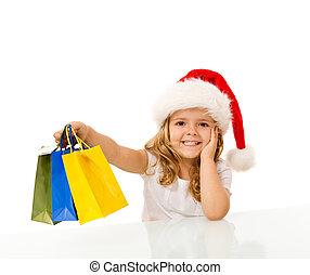 vrolijke , klein meisje, kerst boodschapend doend